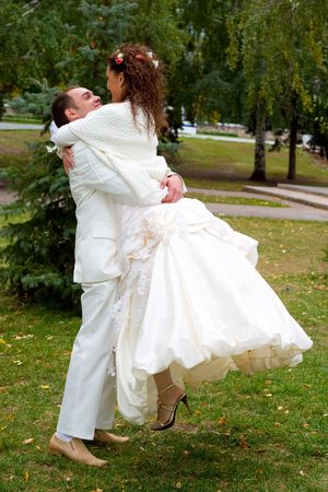 young couple in wedding wear walking in the park Stock Photo - 1988648