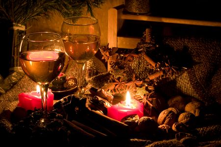 Christmas still-life - candles, cookies, cones, nuts and spices with two glasses of wine Stock Photo - 2145835