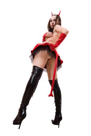 Beautiful model in devils costume, focus on boots photo