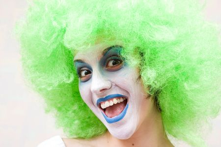 spooky female clown in heavy stage make-up photo