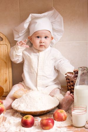 little boy in the cook costume at the kitchen Stock Photo - 2900195