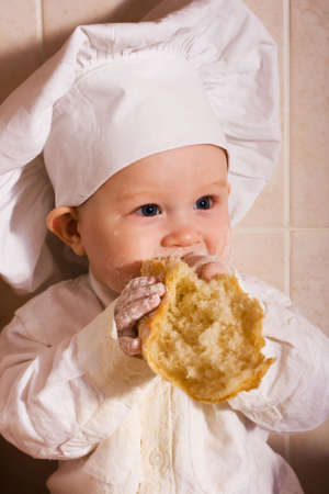 little boy in the cook costume at the kitchen Stock Photo - 3086005