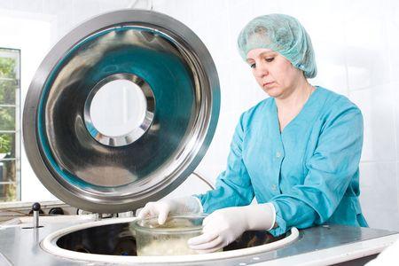 graft: Woman preparing bones transplants in bone bank