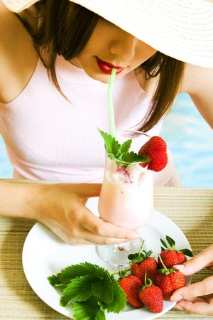 pool party: Girl at vacation with cold strawberry cocktail Stock Photo