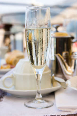 Glass of champagne on breakfast in hotel restaurant