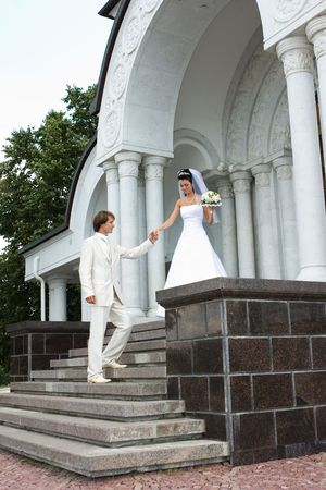 Bride and groom at the church right after ceremony photo