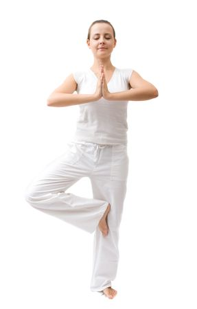 Beautiful young woman in white dress meditating photo