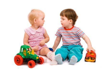 Little girl and boy playing together. Isolated on white background photo