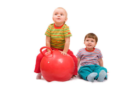 Boy and girl doing exercises with big red ball. Isolated on\ white