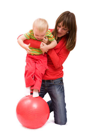 Mother and her little daughter doing exercises. Isolated over white Stock Photo - 4159732