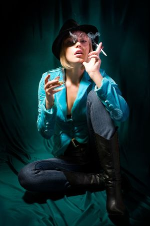 Portrait of young beautiful girl in black hat with cigarette photo