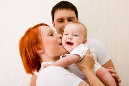 Happy family - father, mother and their cute little baby photo