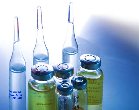 pharmacy equipment: Flasks with medicines and syringe. Blue tone special FX