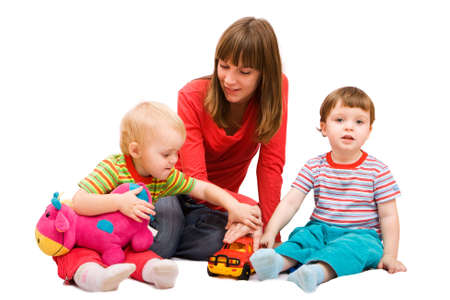 Little girl and boy playing together with mother. Isolated over white photo