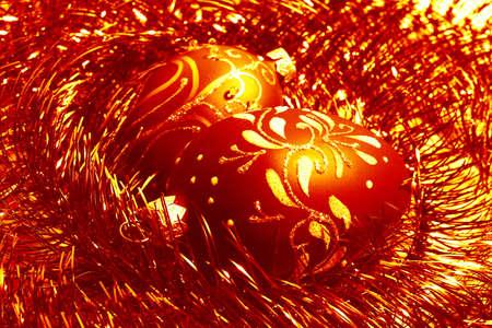 tawdry: red christmas balls and shiny spangle, soft-focused closeup Stock Photo
