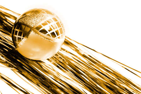tawdry: yellow christmas ball and shiny spangle. Isolated on white background Stock Photo