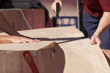 ply: Carpenters sawing plywood Stock Photo