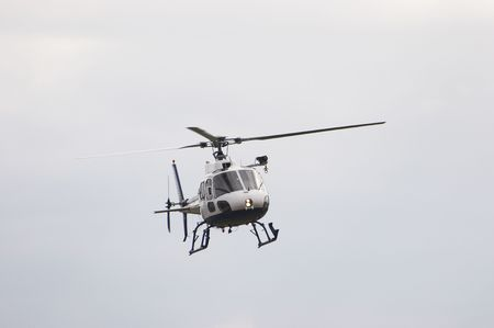 on the skids: Squirrel helicopter in flight