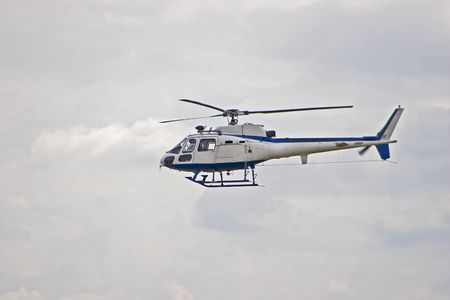 on the skids: Squirrel Helicopter in flight Stock Photo