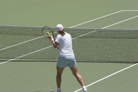 backhand: Tenis jugador realizar una volea de rev�s en la red