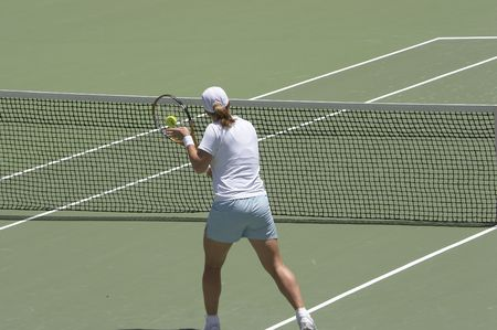 Tennis player performing a backhand volley at the net Stock Photo - 412718