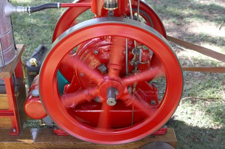 flywheel: Turning flywheel on an engine