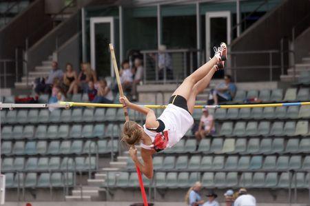 Pole Vaulter on the way up photo