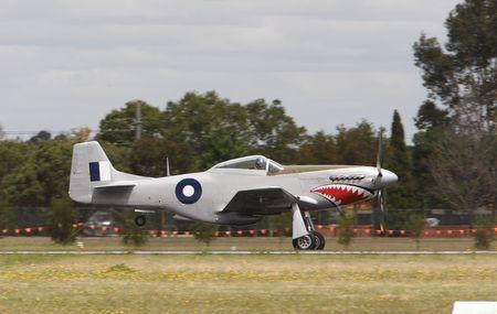 world war two: A world war two fighter plane landing Stock Photo