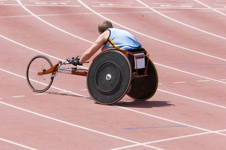 physically: A physically handicapped athlete on the running track in a specially constructed wheelchair