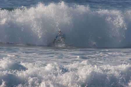 midst: A surfer in the midst of a breaking wave Stock Photo