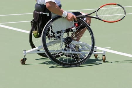 disabled sports: A wheelchair bound athlete on the tennis court