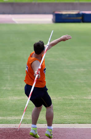 javelin: An athlete throwing a javelin in a sporting event Stock Photo