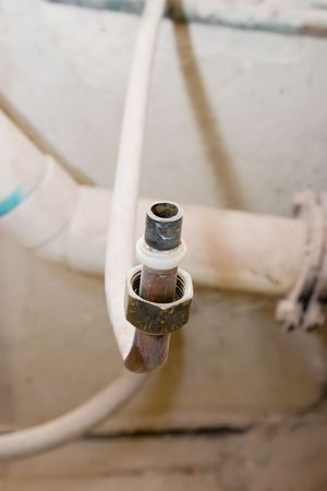 clamped: A clamped copper water pipe Stock Photo