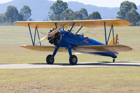 struts: Bi-Plane on the runway warming up Stock Photo