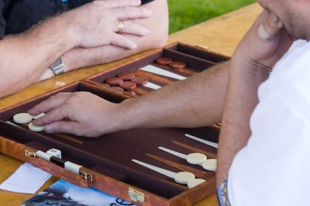 backgammon: Backgammon players having a game Stock Photo
