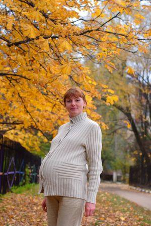 Pregnant woman walk in autumn park #2 photo