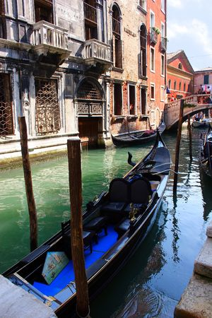 Venice gondola on canal #1 photo