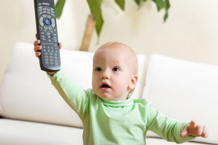 Father switch on a TV, please! Cute little boy at home reach remote control to parent and want to watch TV.