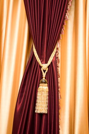Purple velvet curtain with golden tassel. Close-up Stock Photo - 2444056