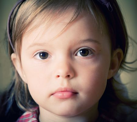 Portrait of a little delicate girl with bow knot on head Stock Photo - 3307924