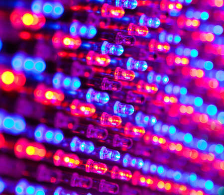 led lighting: RGB led diode display panel with red and blue diodes turned on. Selective focus. Shallow depth of field.