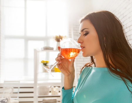 Beautiful woman tasting a glass of rose wine. photo