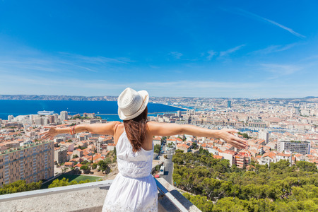 hi hat: Hello, Marseille! Girl welcomes the French city of Marseille. Stock Photo