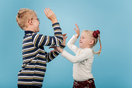 brother sister fight: Brother and sister start a playful fight with each other.