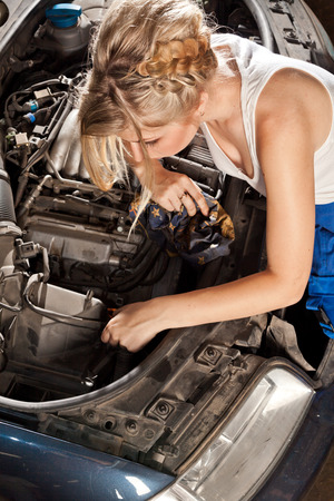 perplexity: Girl trying to repair their own broken car working on the transmission.