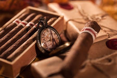 smoking a cigar: Time to enjoy! Two parcels with top quality Cuban cigars - a great gift from best friend Stock Photo