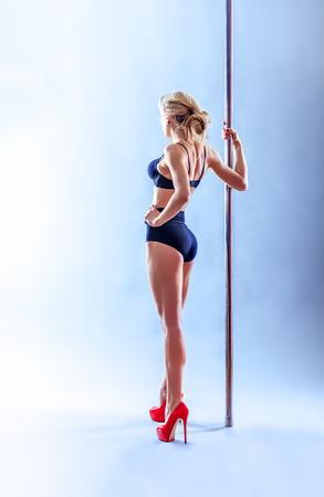 Beautiful blonde sexy pole dance woman. photo