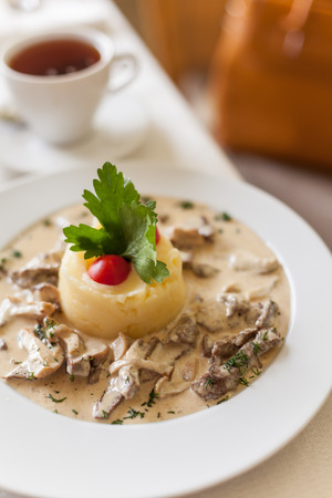 fricassee: Fricassee of veal in a mild cream sauce. Served with mashed potatoes and porcini mushrooms. Stock Photo
