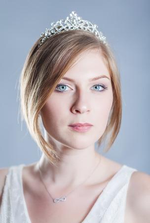 diadem: Portrait of a beautiful woman in a diadem. Studio shot