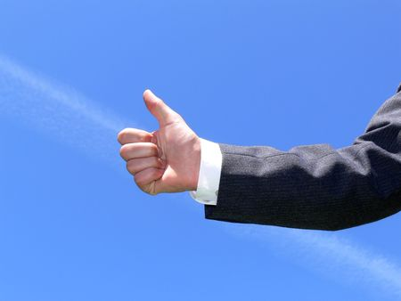 yeah: Businessmans Hand With Thumb Up